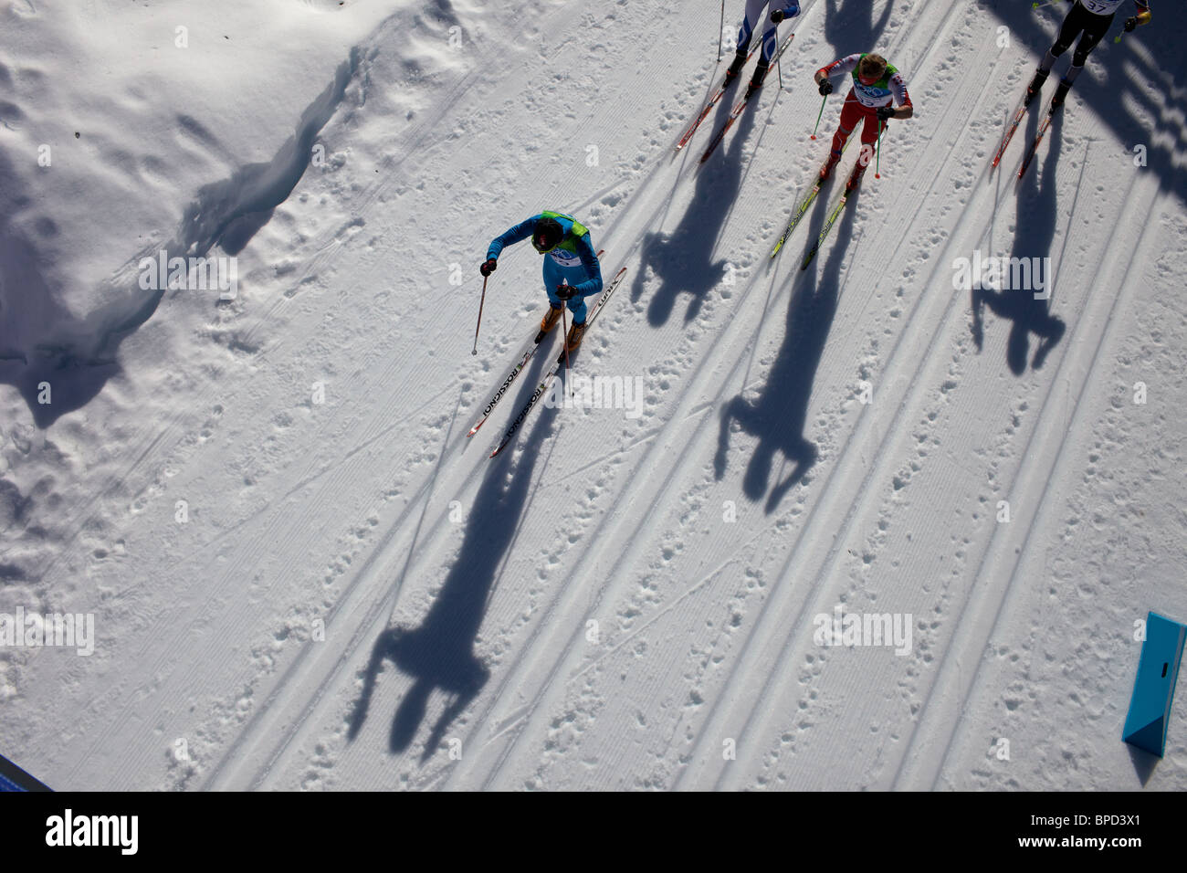 Winter Olympics, Vancouver, 2010 The shadows of athletes cast on the surface of the snow during the Men's 30km Pursuit. Stock Photo