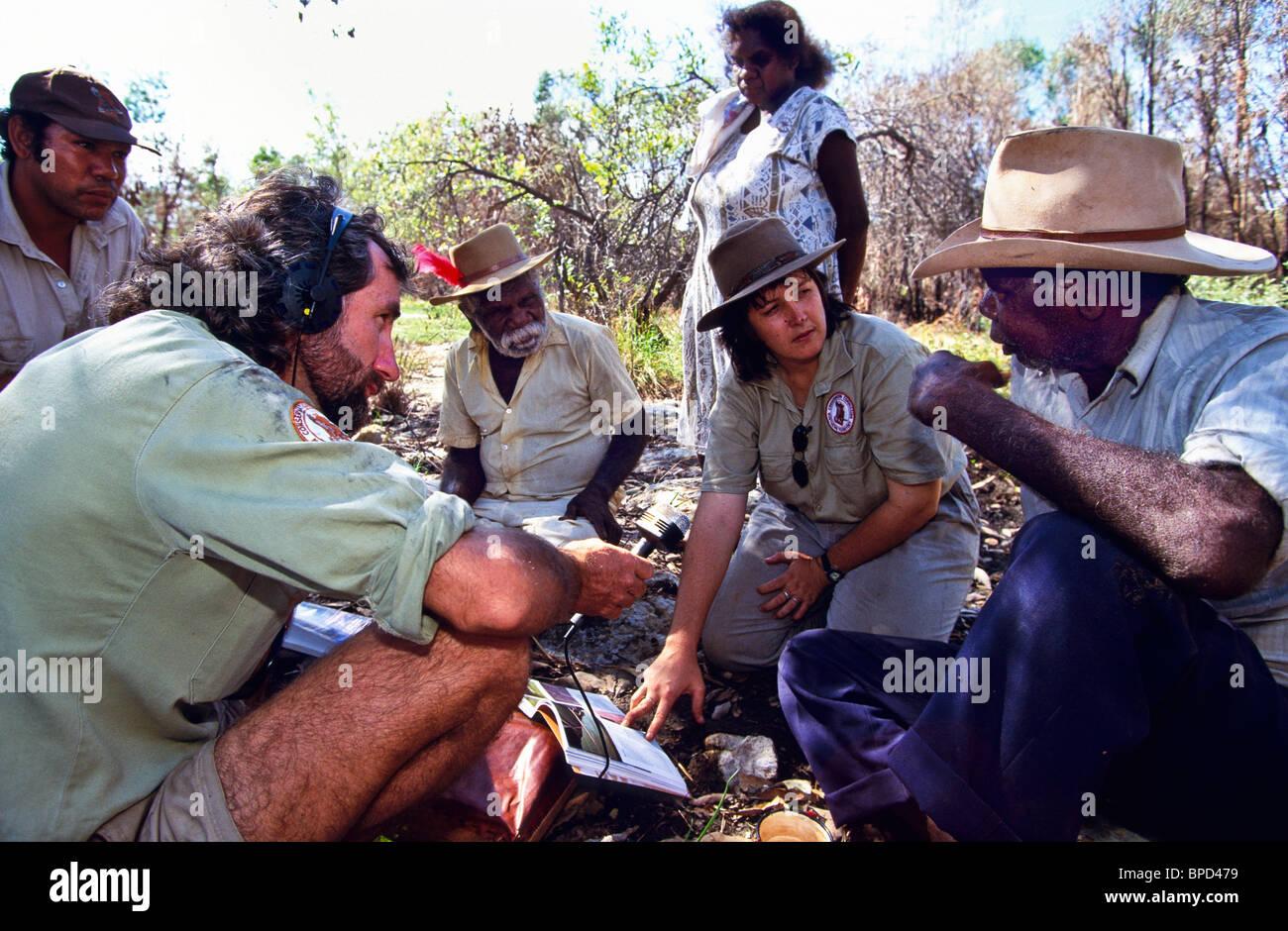 Ethnobotanist interviewing indigenous Australians, Australia - Stock Image