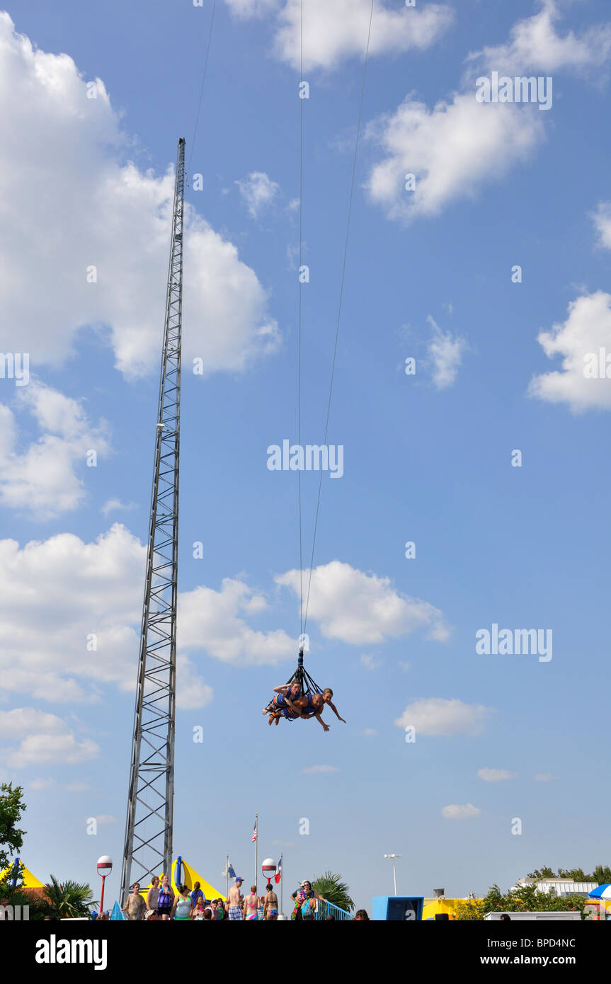 Sky coaster swing at Hurricane Harbor waterpark , Six Flags Over Texas amusement park, Arlington, TX, USA Stock Photo