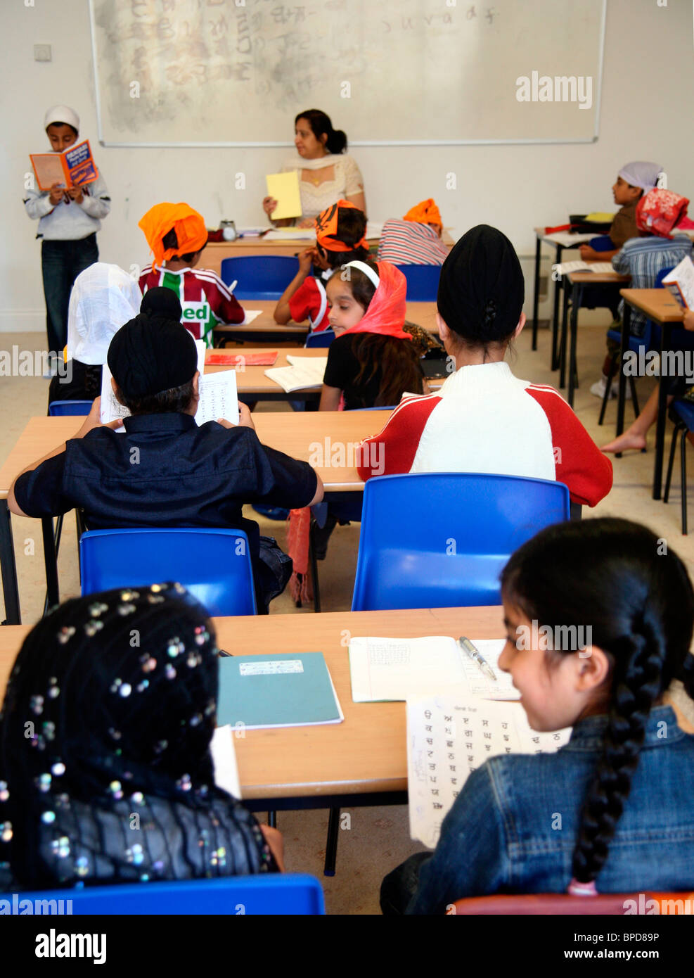 Punjabi lesson for Sikh children in a classroom of the gurdwara - Stock Image