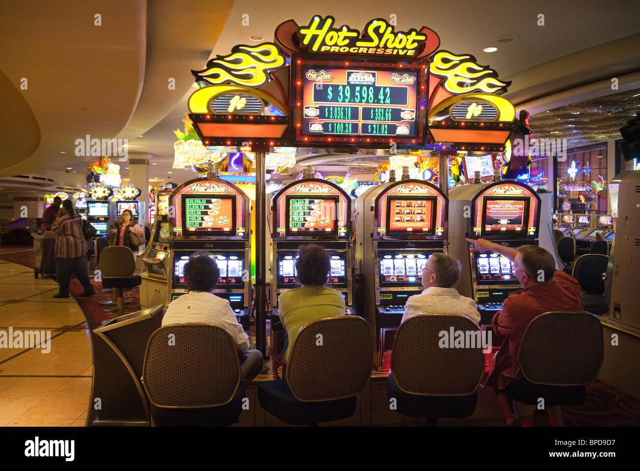 Gamblers trying their luck on the slot machines, Harrah's Casino, Las Vegas, Nevada, USA - Stock Image