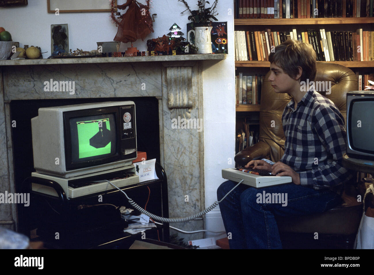 children in the eighties playing on a  computer - Stock Image