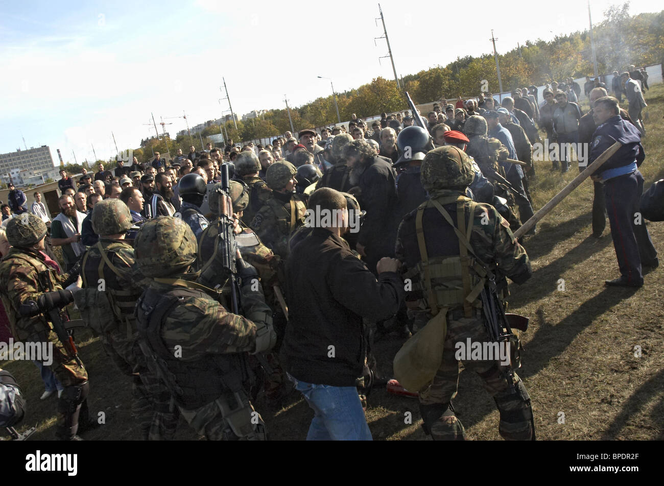 Mass clashes with Crimean Tatars over illegal land seizures in Simferopol - Stock Image