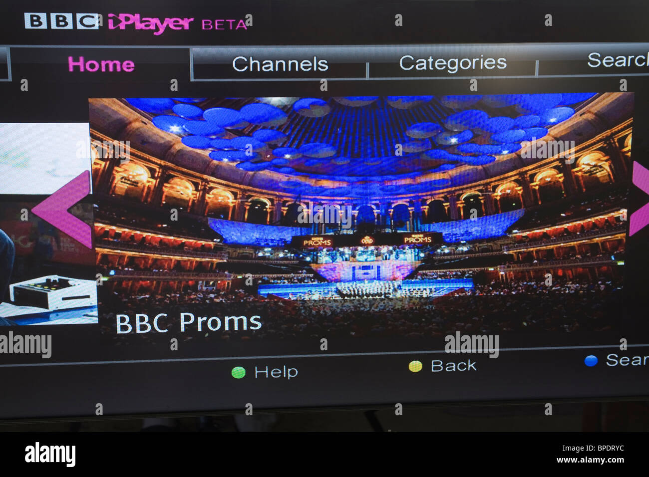 Close up of a flat screen television set showing the BBC i Player BETA home page on Freesat - Stock Image
