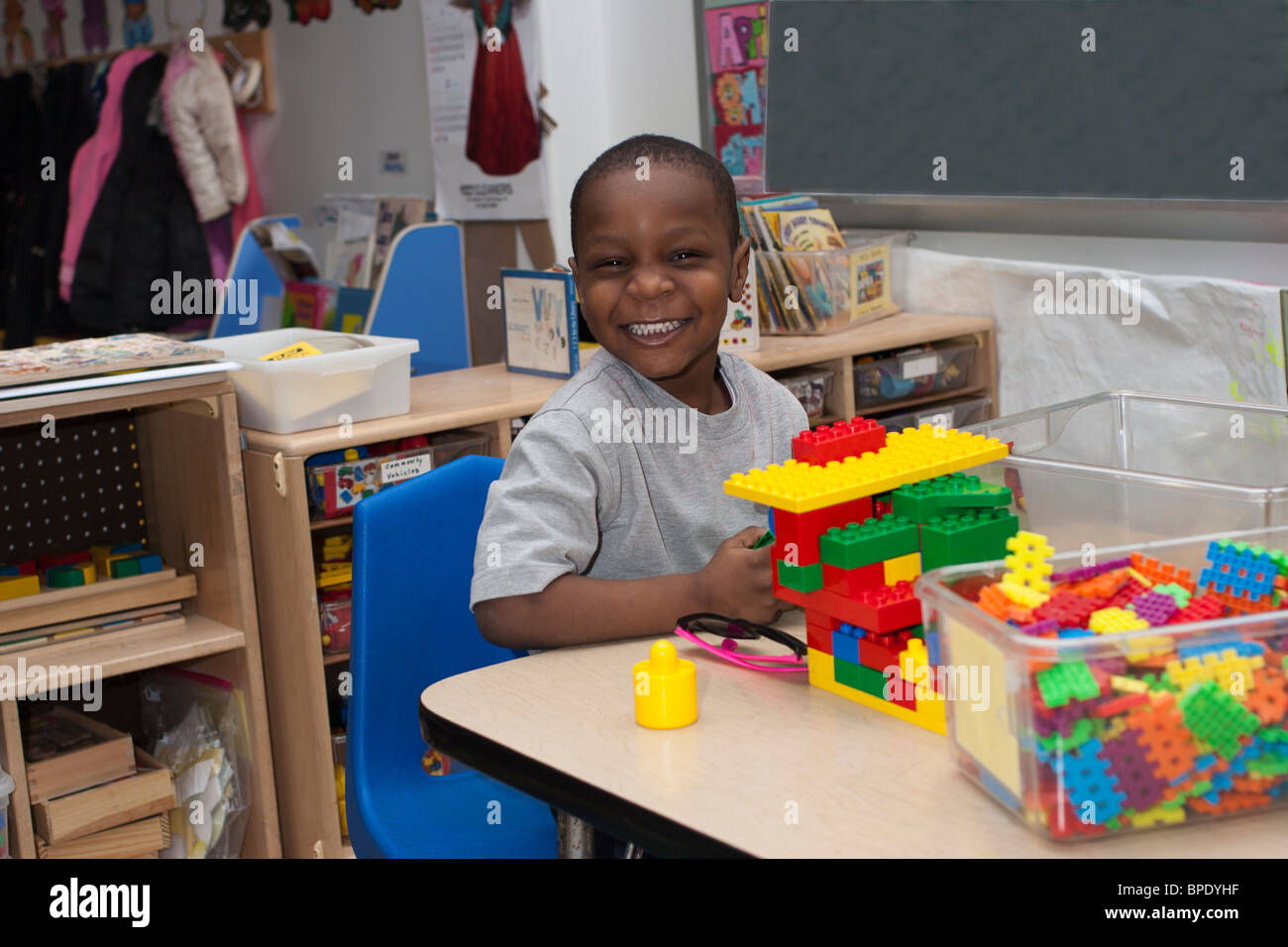 Kinder Garden: African American Preschool Boy Playing With Lego S In The