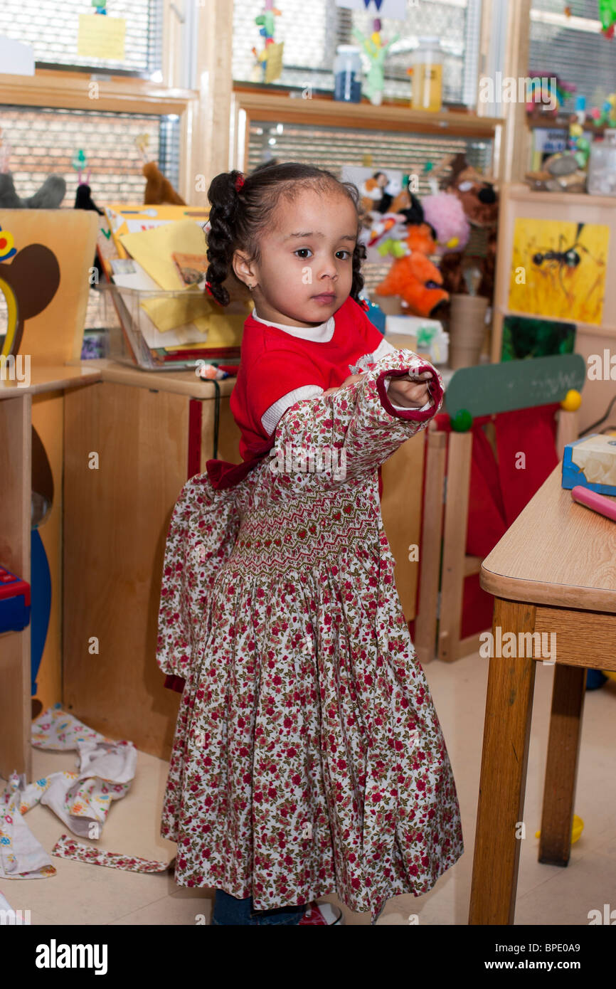Kinder Garden: 4 Year Old Preschool Girl Playing Dress Up At School
