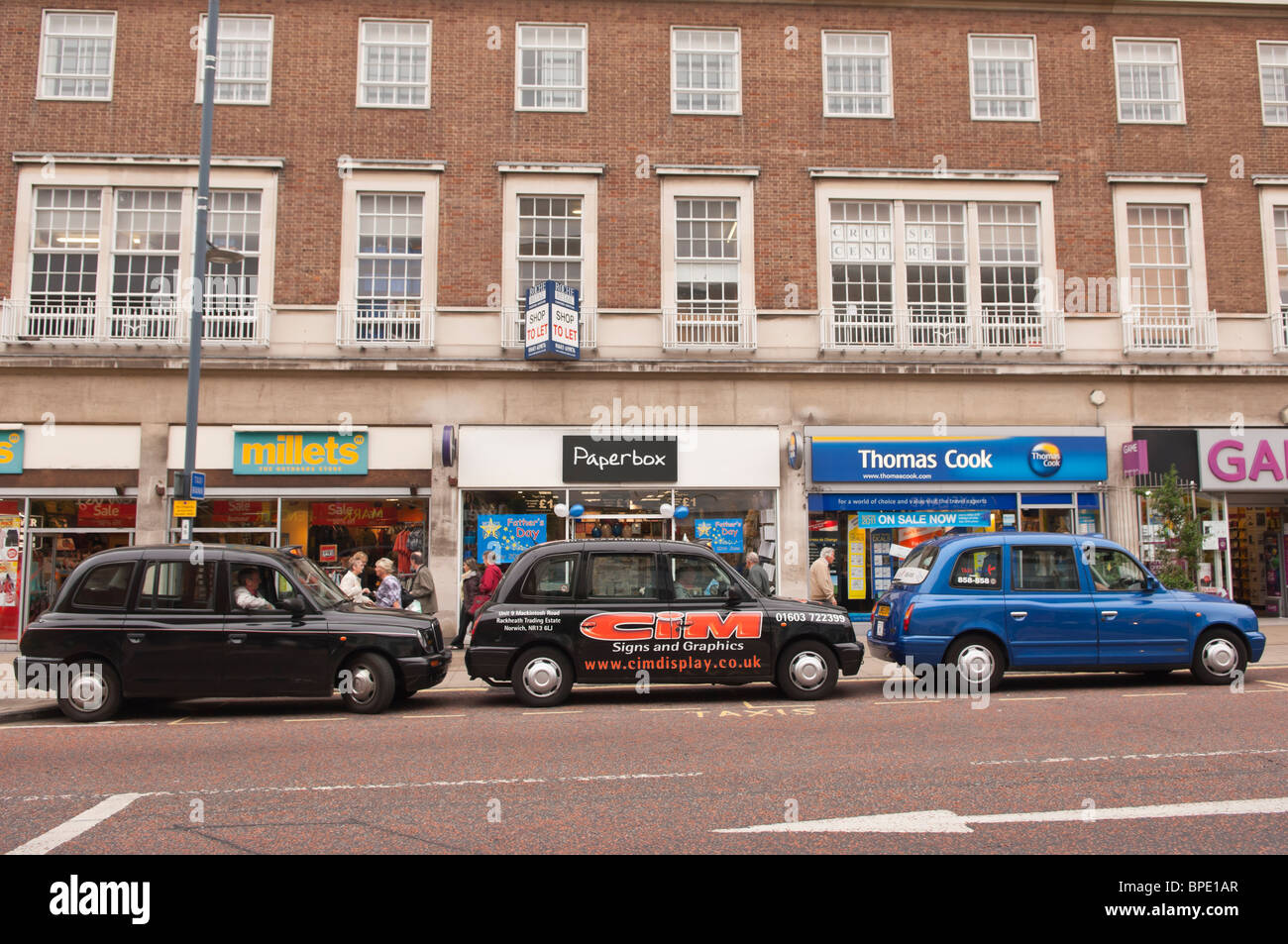 A row of Taxis waiting for customers in Norwich , Norfolk , England , Great Britain , Uk - Stock Image