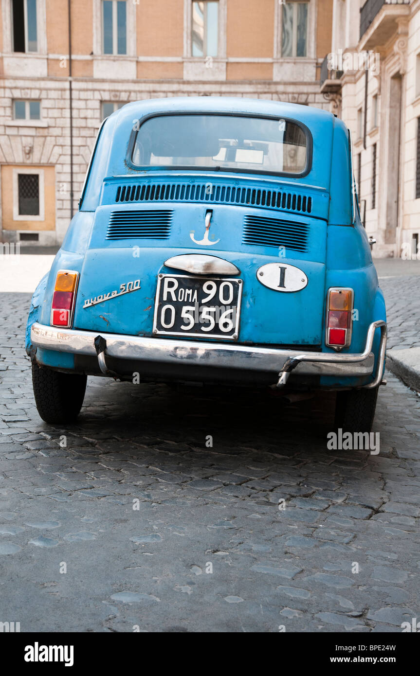 Old blue Fiat 500 car, Piazza Navona, Rome, Italy - Stock Image