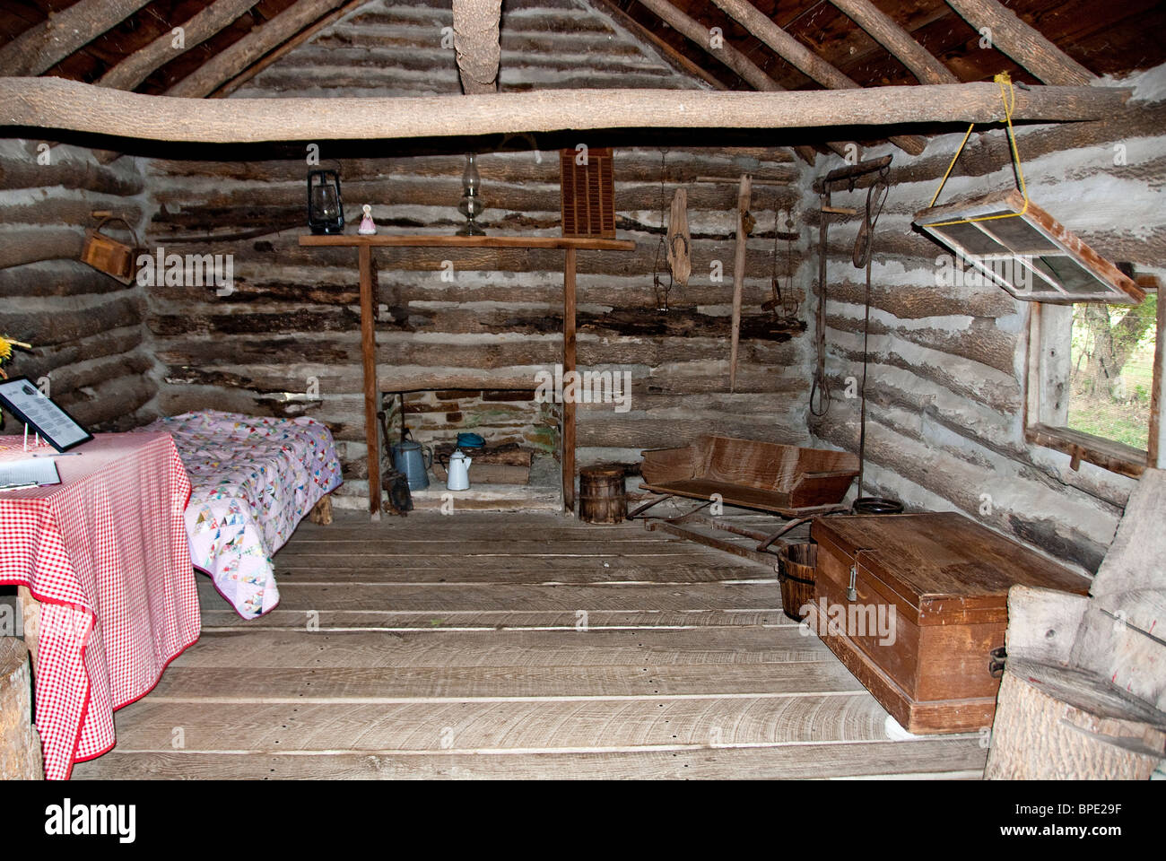 Inside the reconstructed cabin Little House on the Prairie Independence Kansas USA - Stock Image