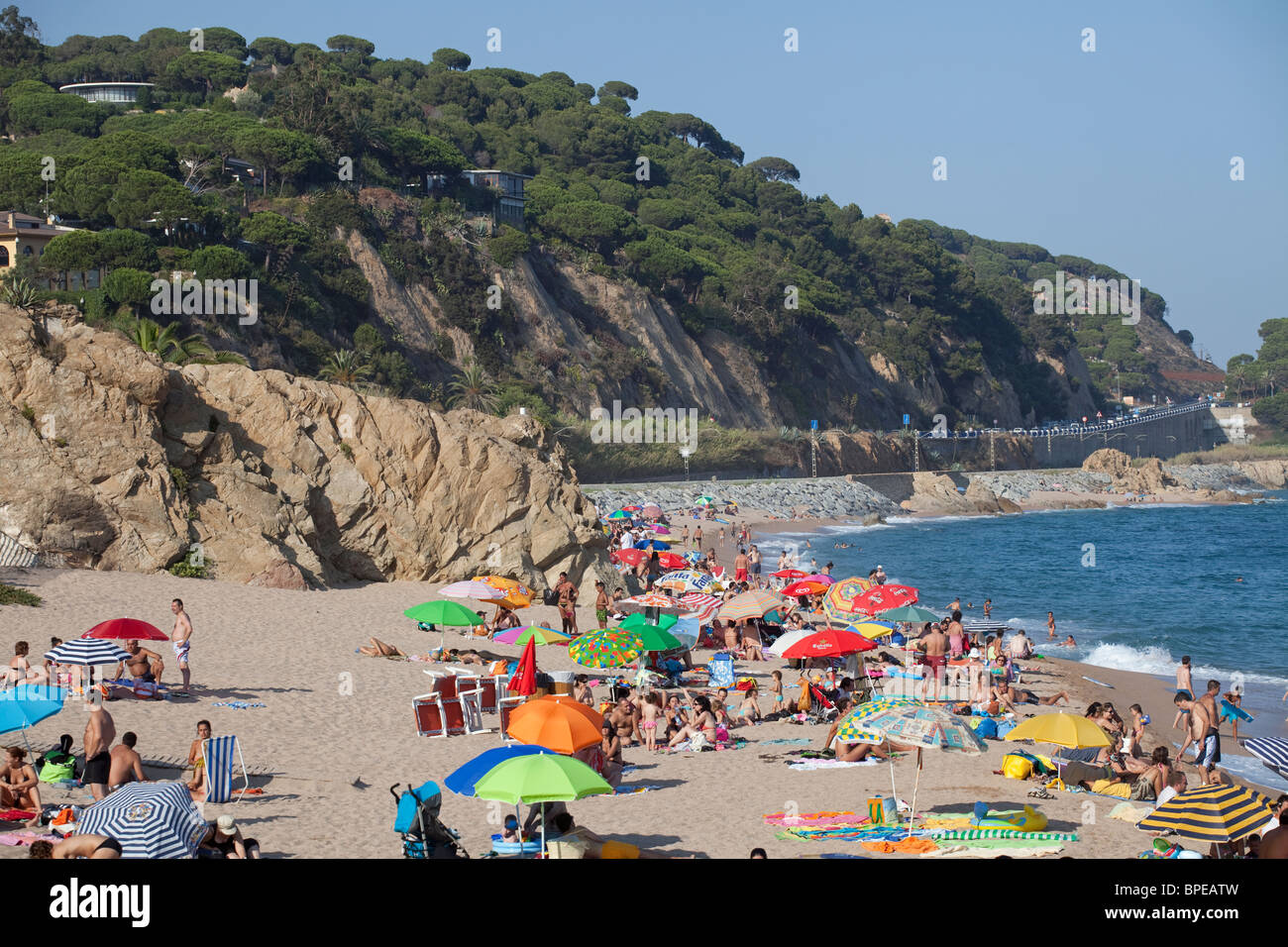 Barcelona Busy beach at Sant Pol de Mar, Spain - Stock Image