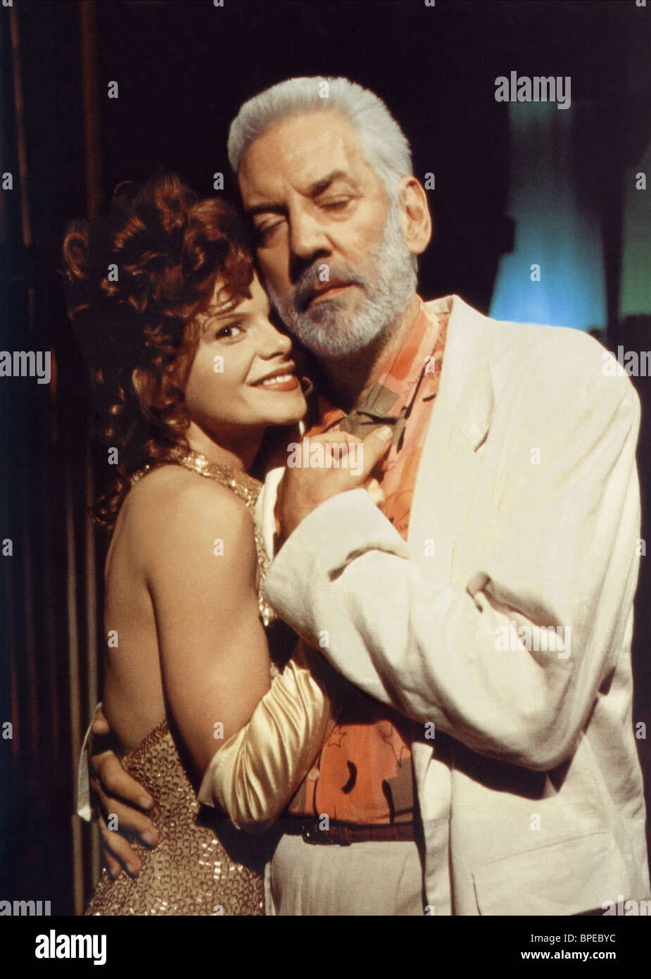 LOLITA DAVIDOVICH & DONALD SUTHERLAND YOUNGER AND YOUNGER (1993) - Stock Image