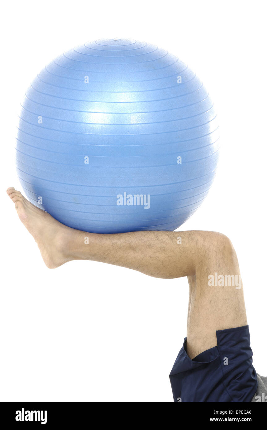 Foot holding exercise ball - Stock Image