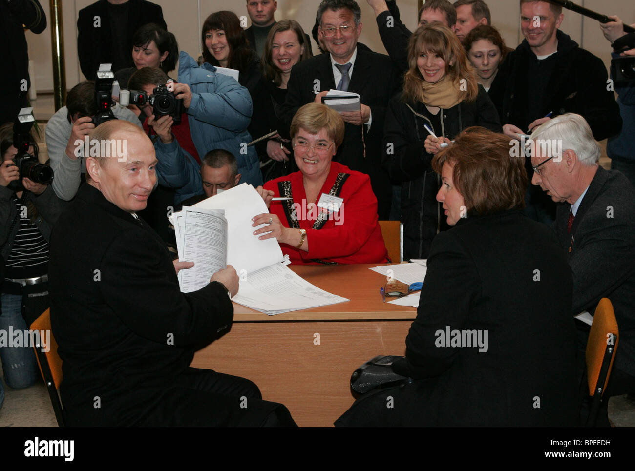 Russian President Vladimir Putin votes for a new president of Russia - Stock Image