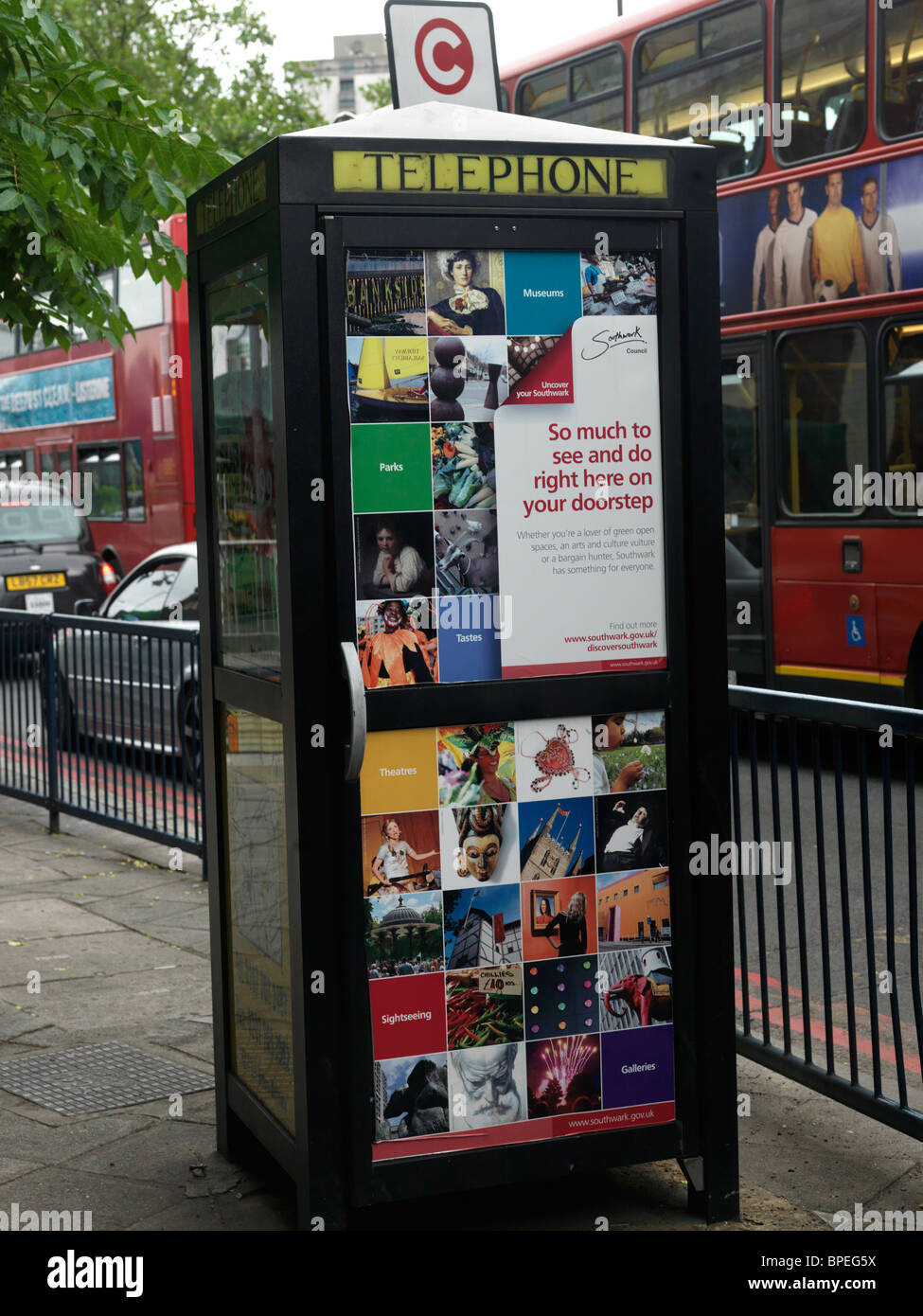 London England Southwark Posters On Telephone Box - Stock Image