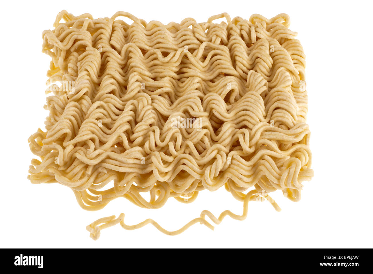 Pile of dried instant noodles - Stock Image