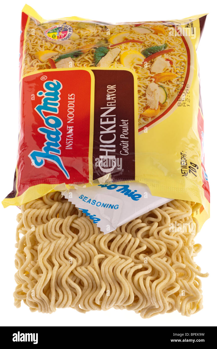 Packet of Indomie dried instant noodles and flavouring in sachet - Stock Image