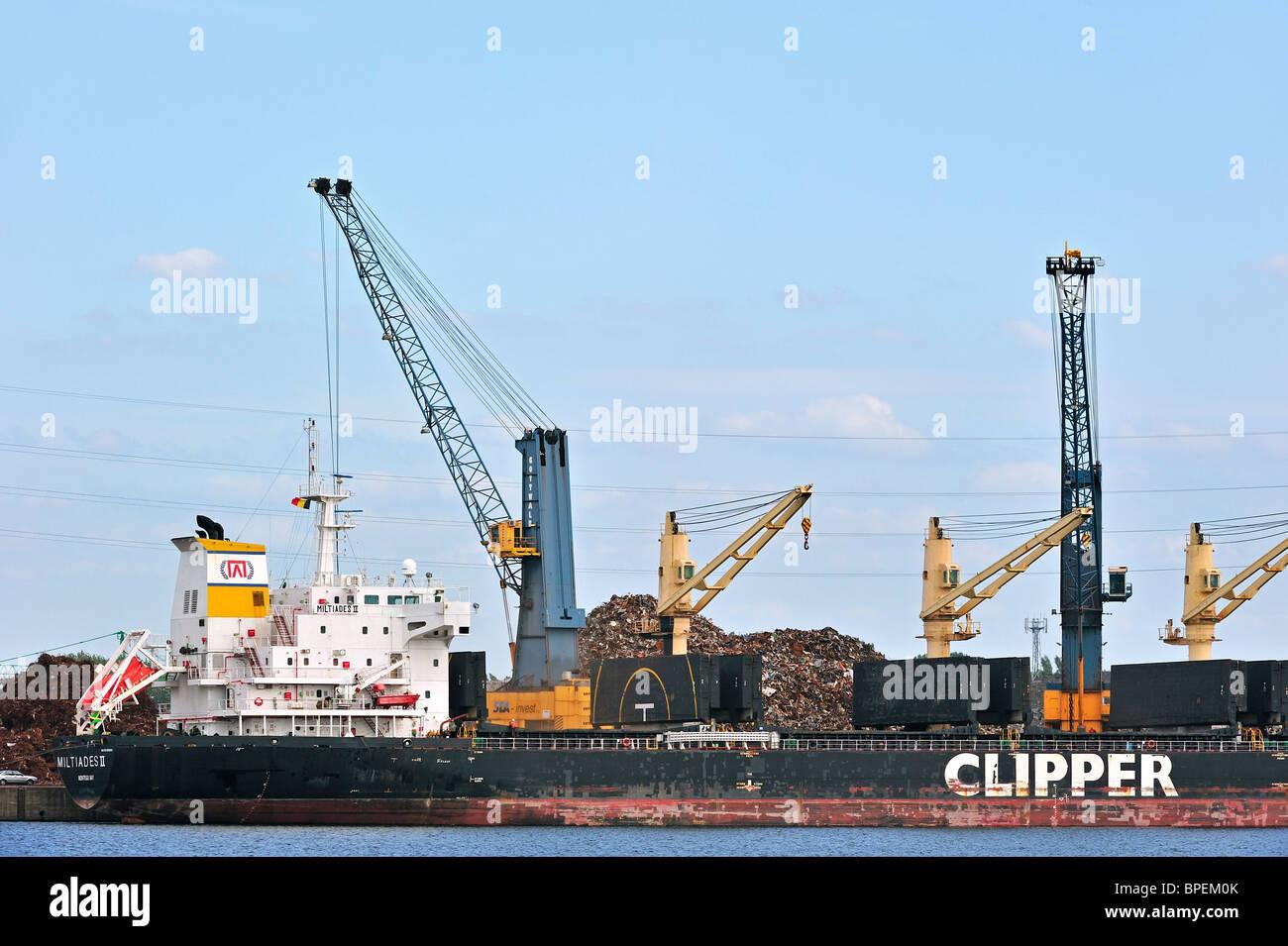 Dock crane loading bulk carrier with recycled scrap metal at Ghent seaport, Belgium - Stock Image