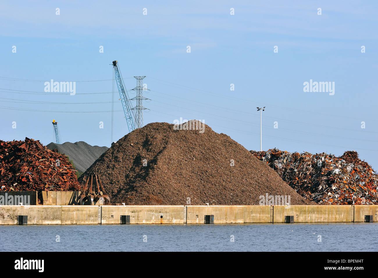 Scrap heap along the Ghent-Terneuzen Canal at Ghent seaport, Belgium - Stock Image
