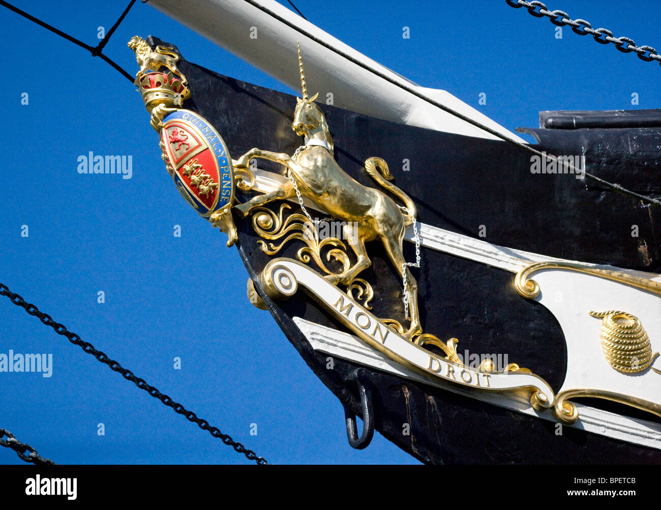 Prow of Brunel's liner SS Great Britain with unicorn and royal coat of arms in dry dock by the floating harbour - Stock Image