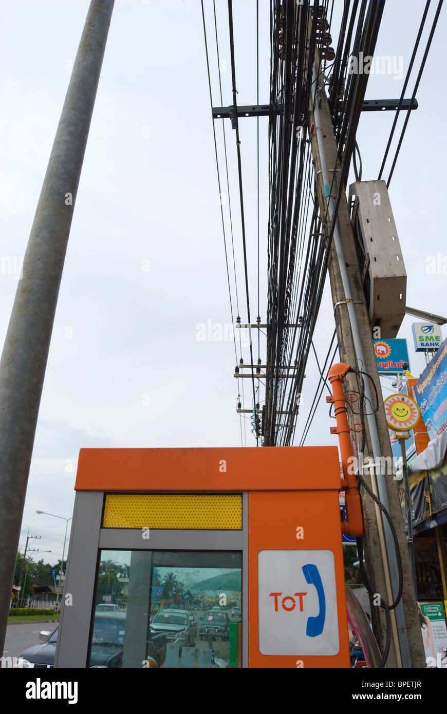 public telephone box with logo of tot, the telephone organisation of thailand, in phetchabun, thailand, south east - Stock Image