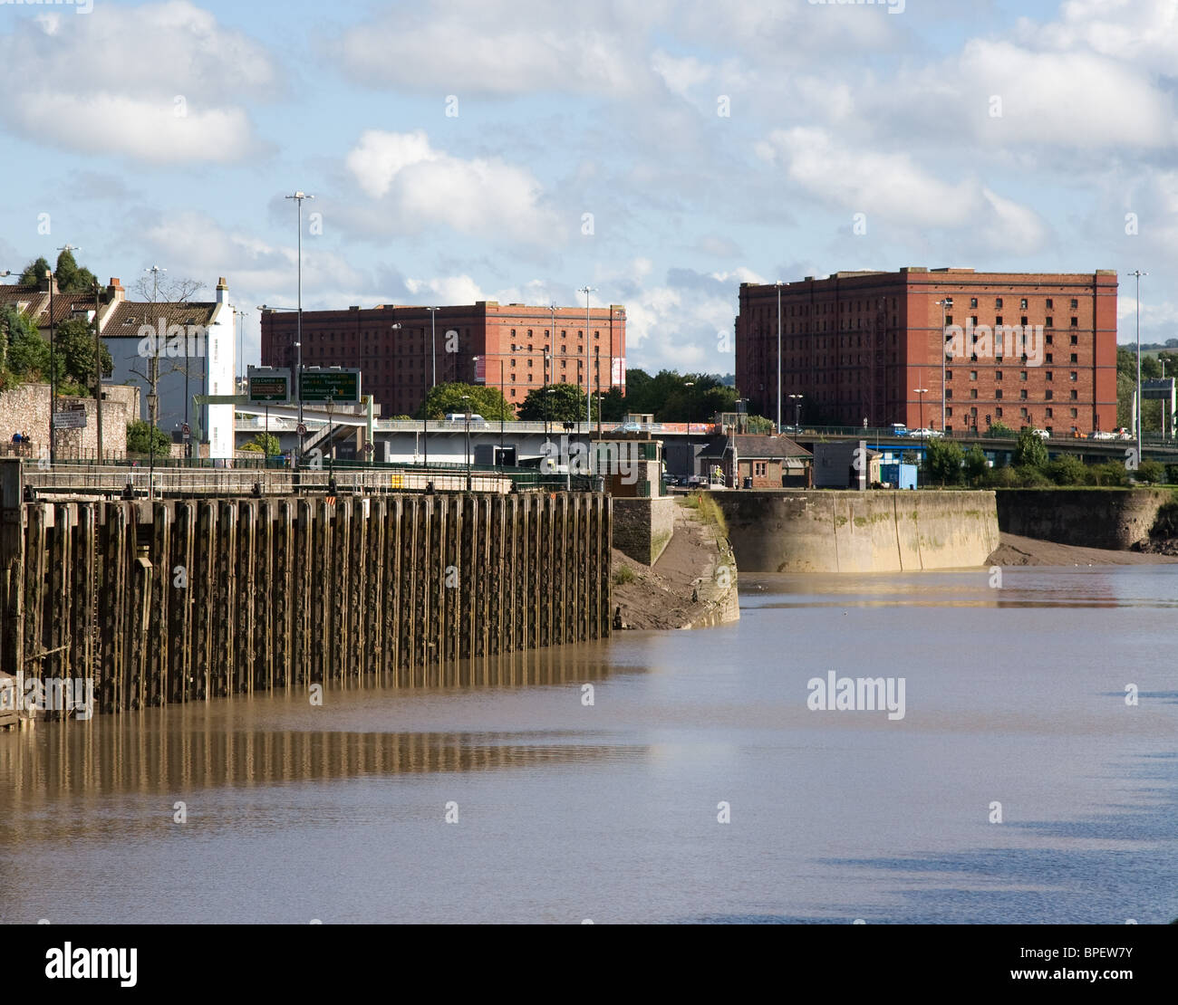Hotwells Bristol UK at Cumberland Basin with old bond warehouses entrance to floating harbour and old shipping wharves - Stock Image