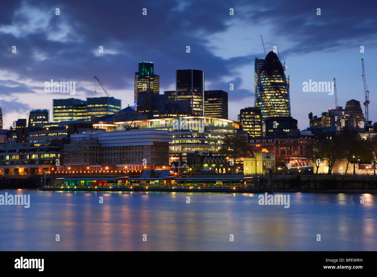 View over the River Thames at night looking toward the financial heart of the City of London - Stock Image