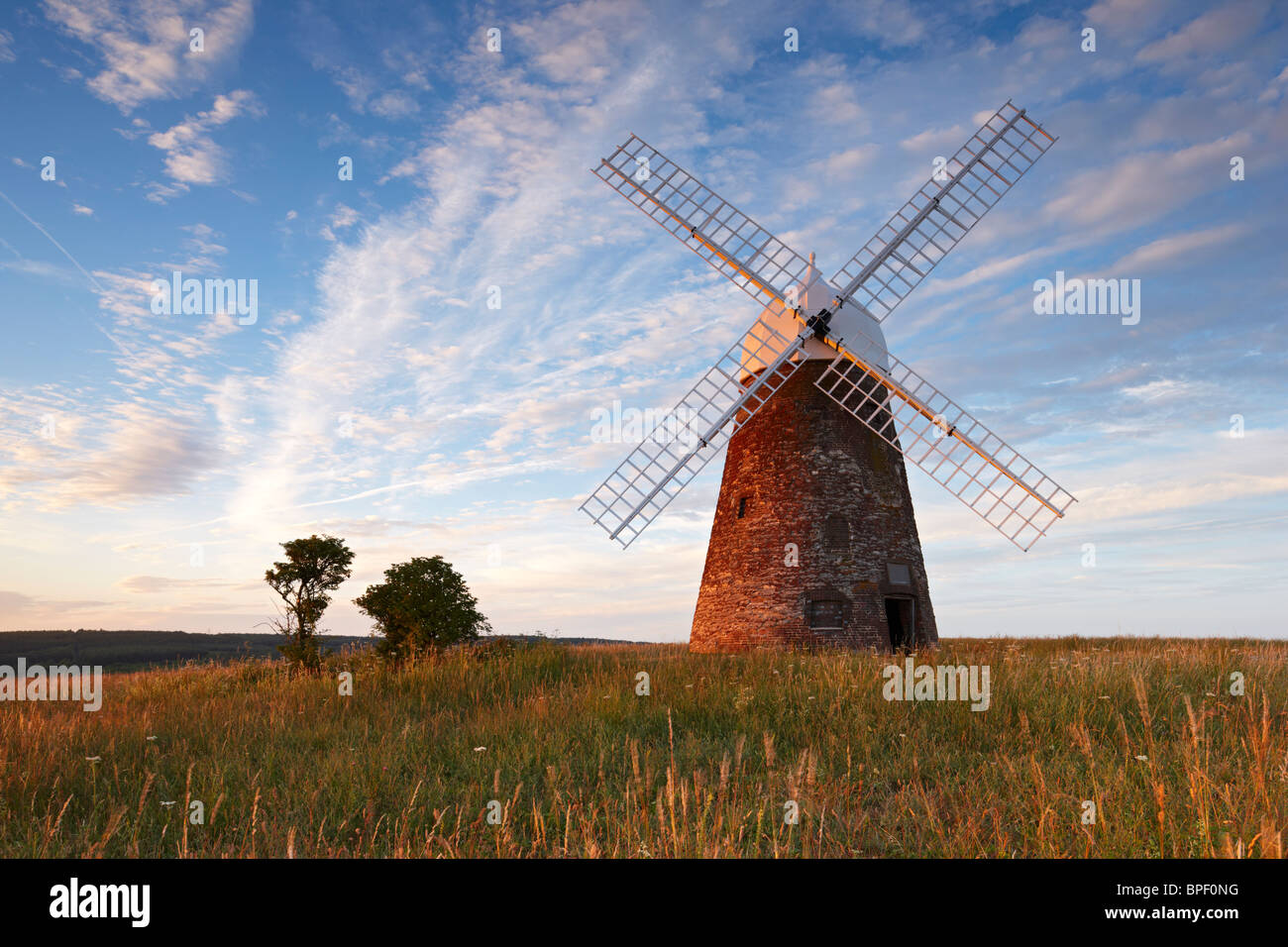 Halnaker windmill standing high up on the South Downs surrounded by the beautiful Sussex countryside on a warm summers Stock Photo