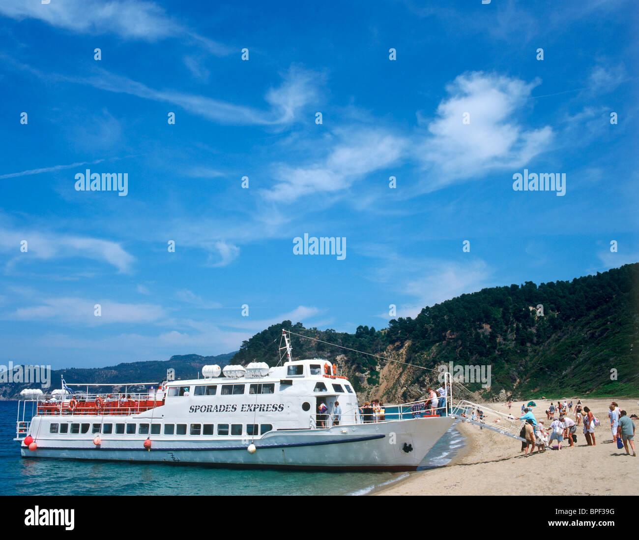 Excursion Boat on Asselinos Beach, Skiathos, Sporades Islands, Greece - Stock Image