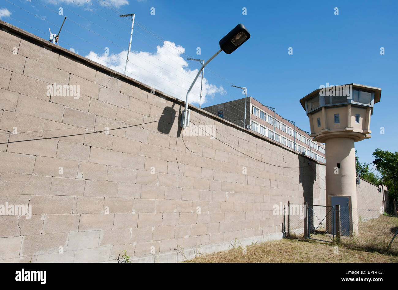 Wall and guard tower at former East German state secret security police or STASI prison at Hohenschönhausen - Stock Image