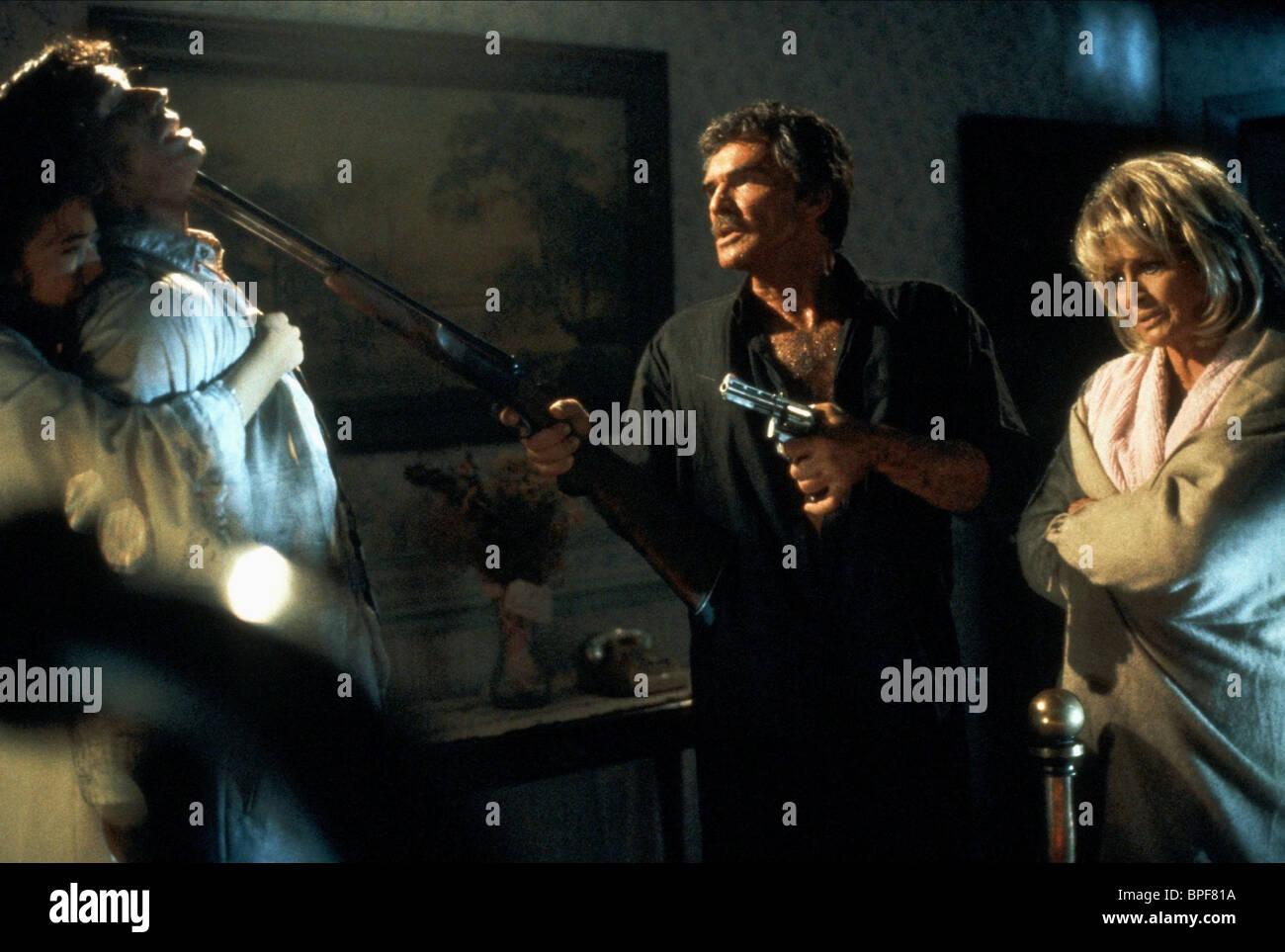 MIA SARA, BRIAN WIMMER, BURT REYNOLDS, ANGIE DICKINSON, THE MADDENING, 1995 - Stock Image