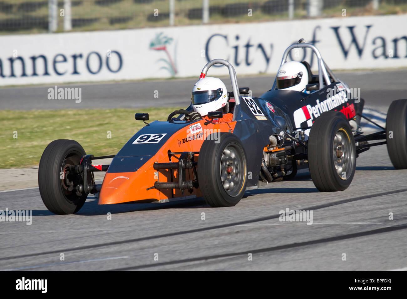 Formula Vee racing at an Australian car race meeting. - Stock Image