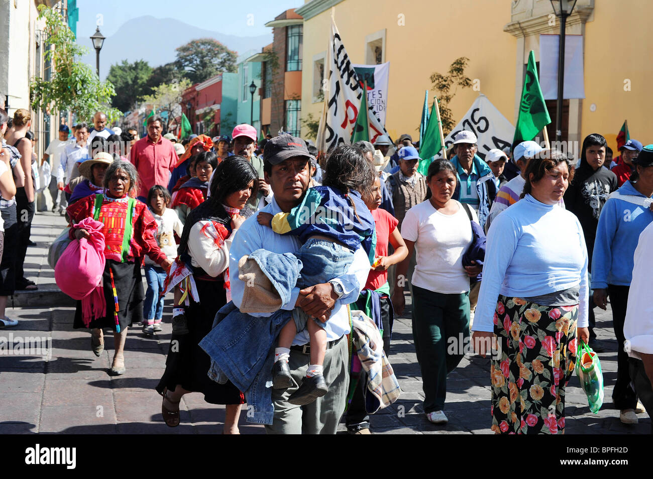 Protesters march to the Zocola in Oaxaca to demand Government reforms and help for the poor. Mexico - Stock Image