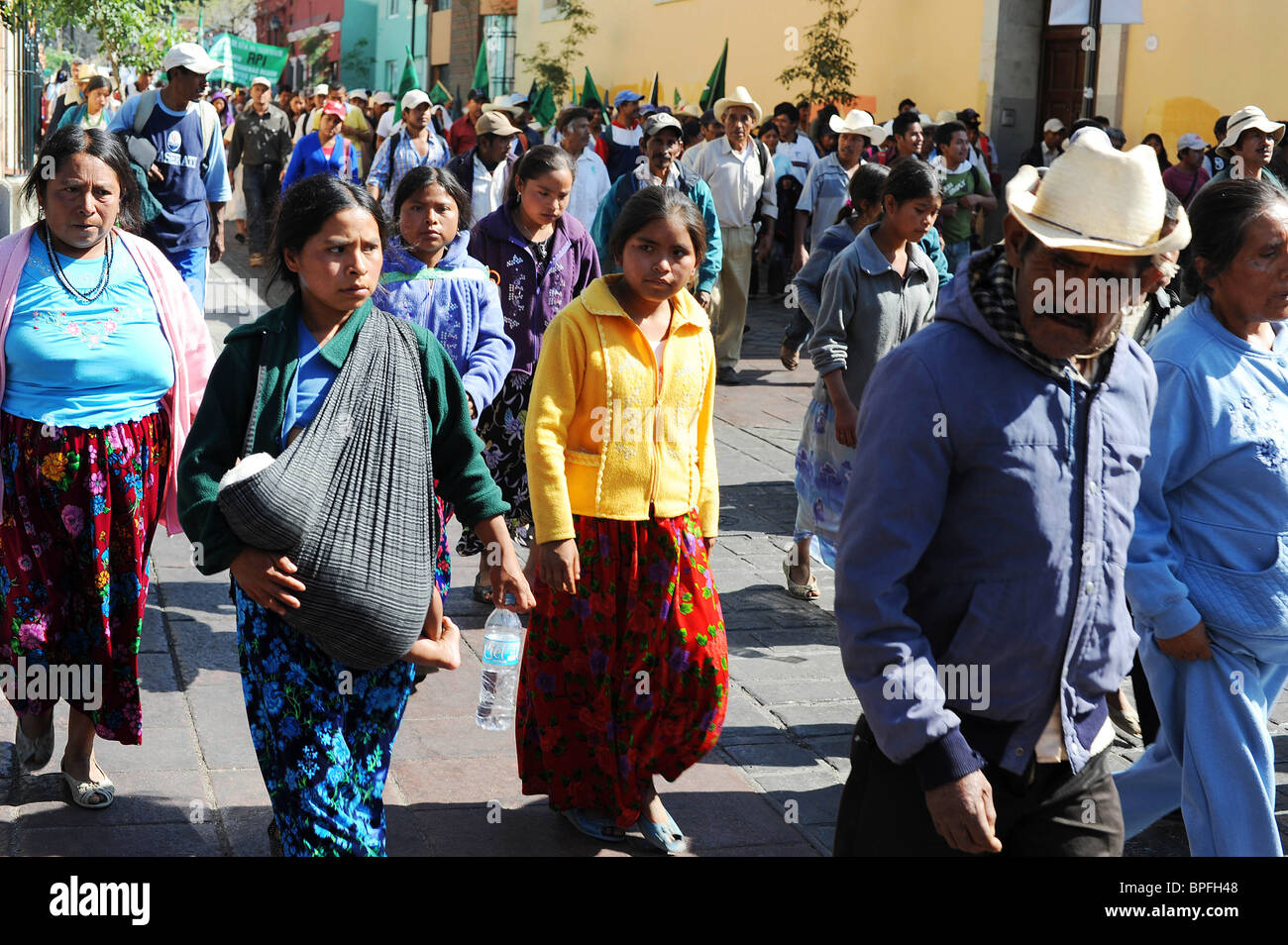 Protesters march to the Zocola to demand for Government reforms and help for the poor. Oaxaca, Mexico - Stock Image