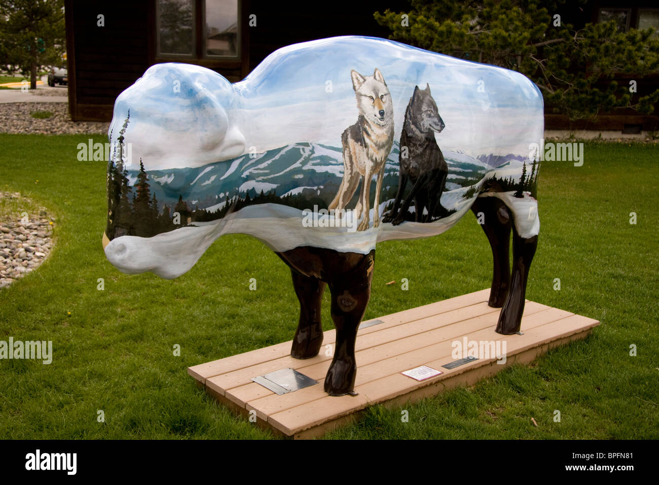 One of a series of painted buffalo as part of an art event at West Yellowstone, Montana, USA - Stock Image