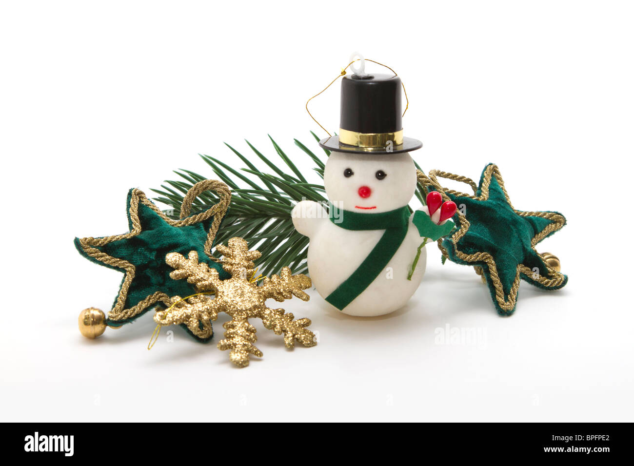 an arrangement of small pretty christmas ornaments on a white background green velvet stars - Cut Out Christmas Decorations
