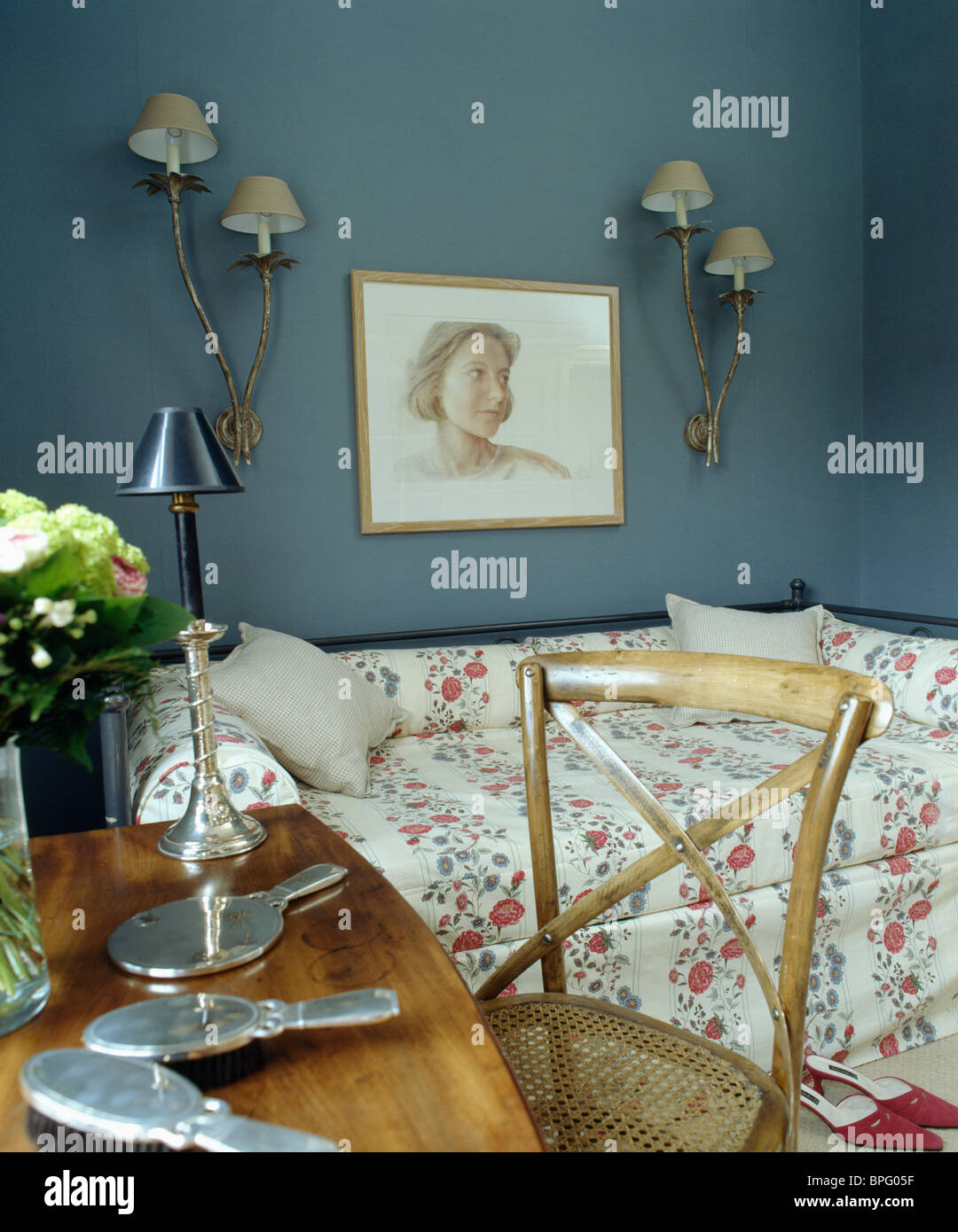 Picture of: Picture And Wall Lights On Wall Above Sofa Bed In Dark Blue Guest Stock Photo Alamy
