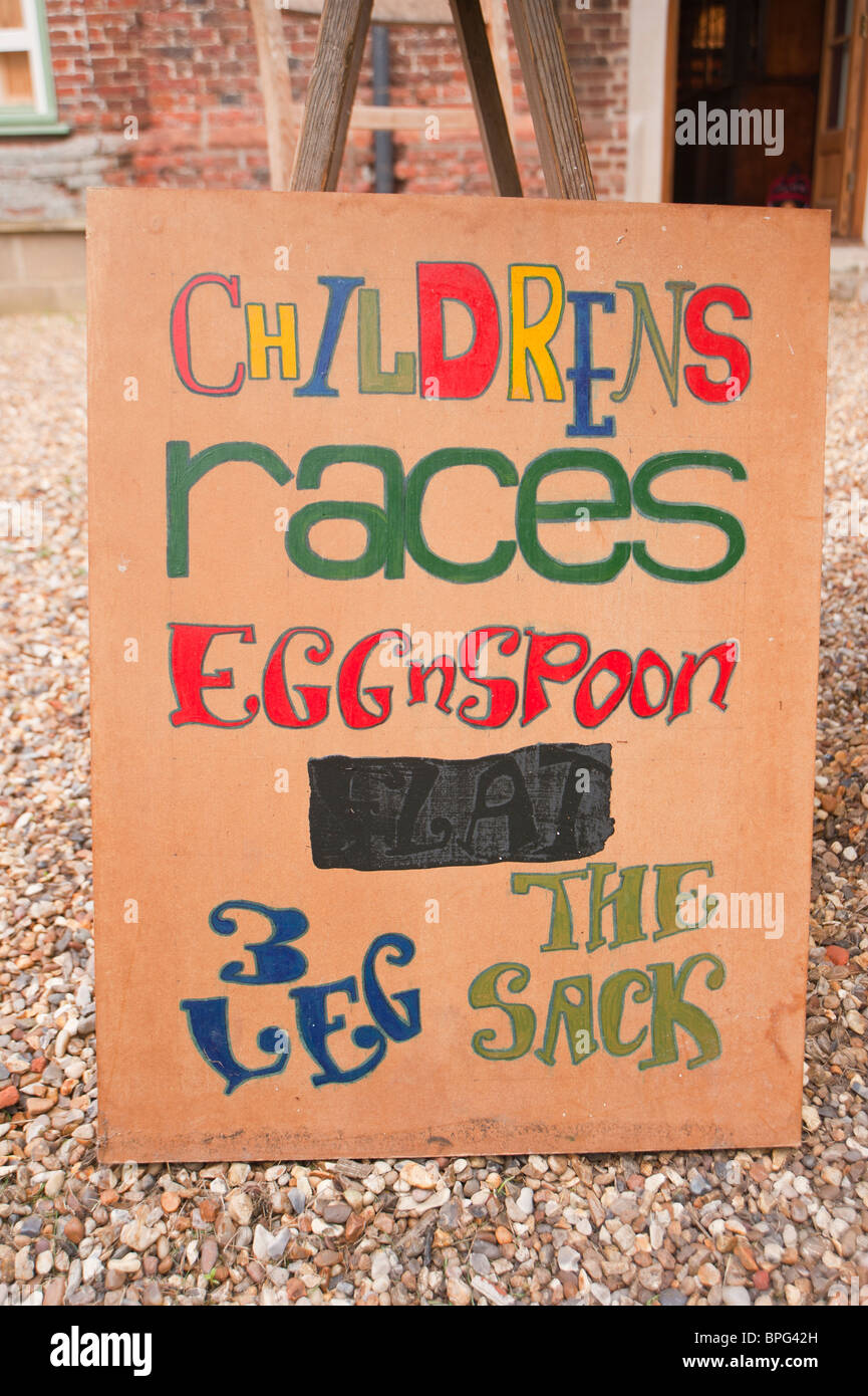 A sign advertising childrens races at a village fete in Weston , Suffolk , England , Great Britain , Uk - Stock Image