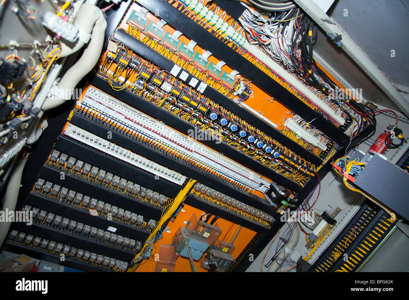 Electrical control panel in a derelict factory, wires and switches ...