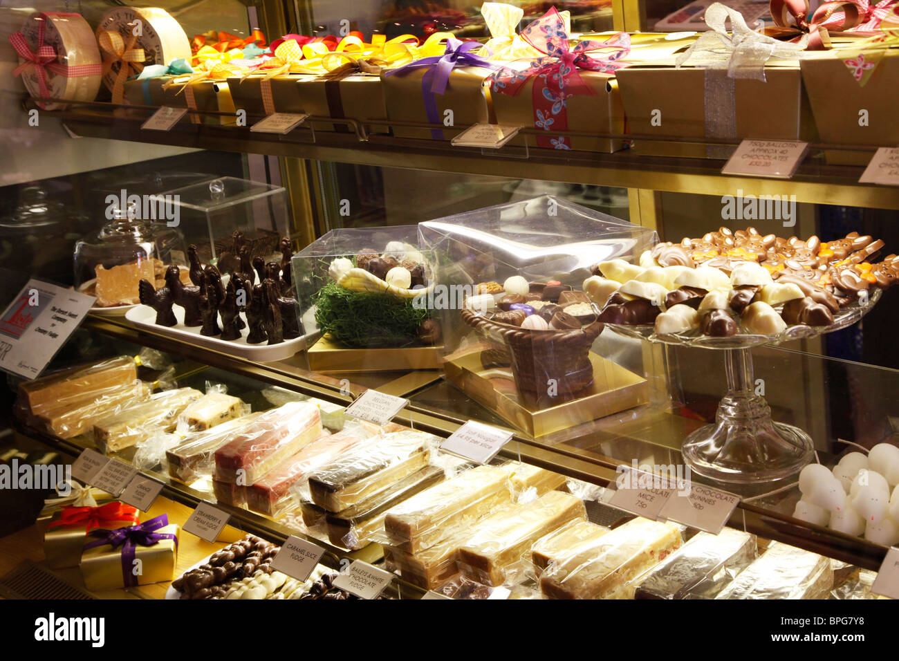 Chocolates and confectionery in a specialist upmarket shop in Salisbury, Wiltshire, England, UK - Stock Image