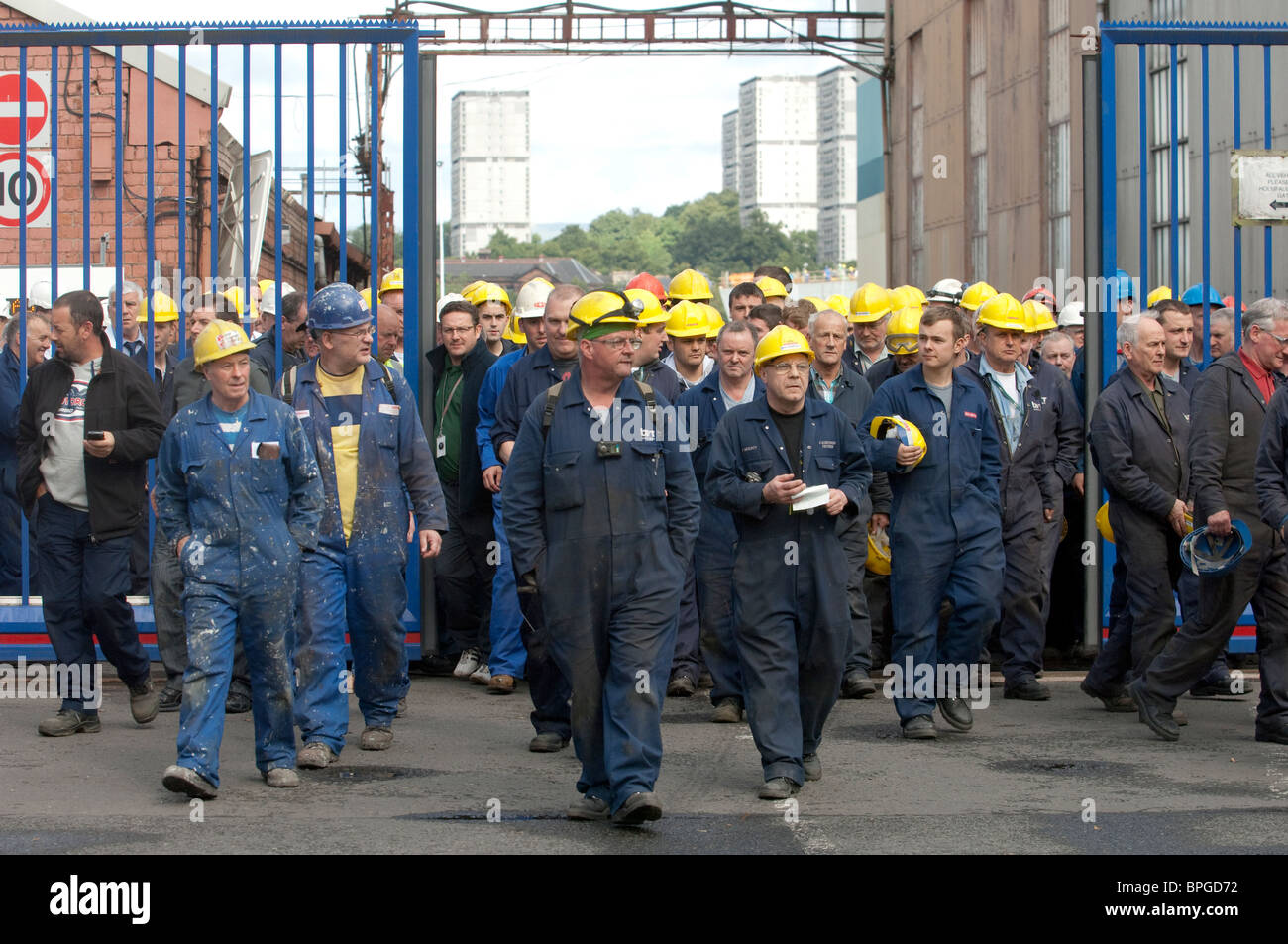 Workers at BAE Systems Govan Shipyard in Glasgow leave via the front entrance. - Stock Image