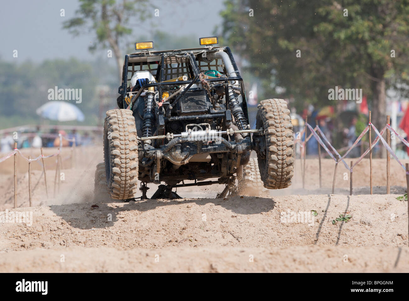 Off-road dune buggy competing in the mud Stock Photo