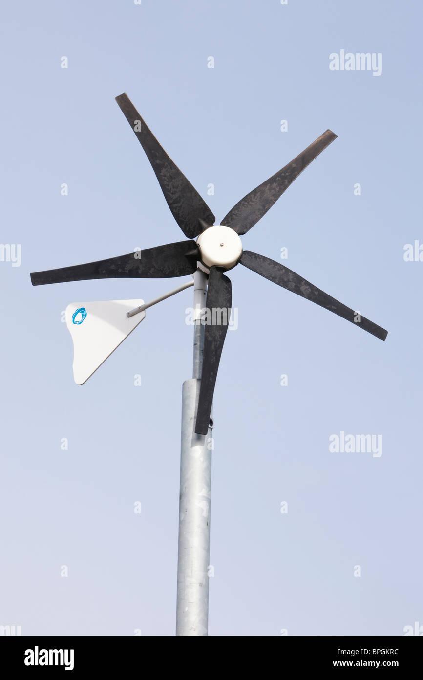 Eco friendly wind turbine in school grounds - Stock Image