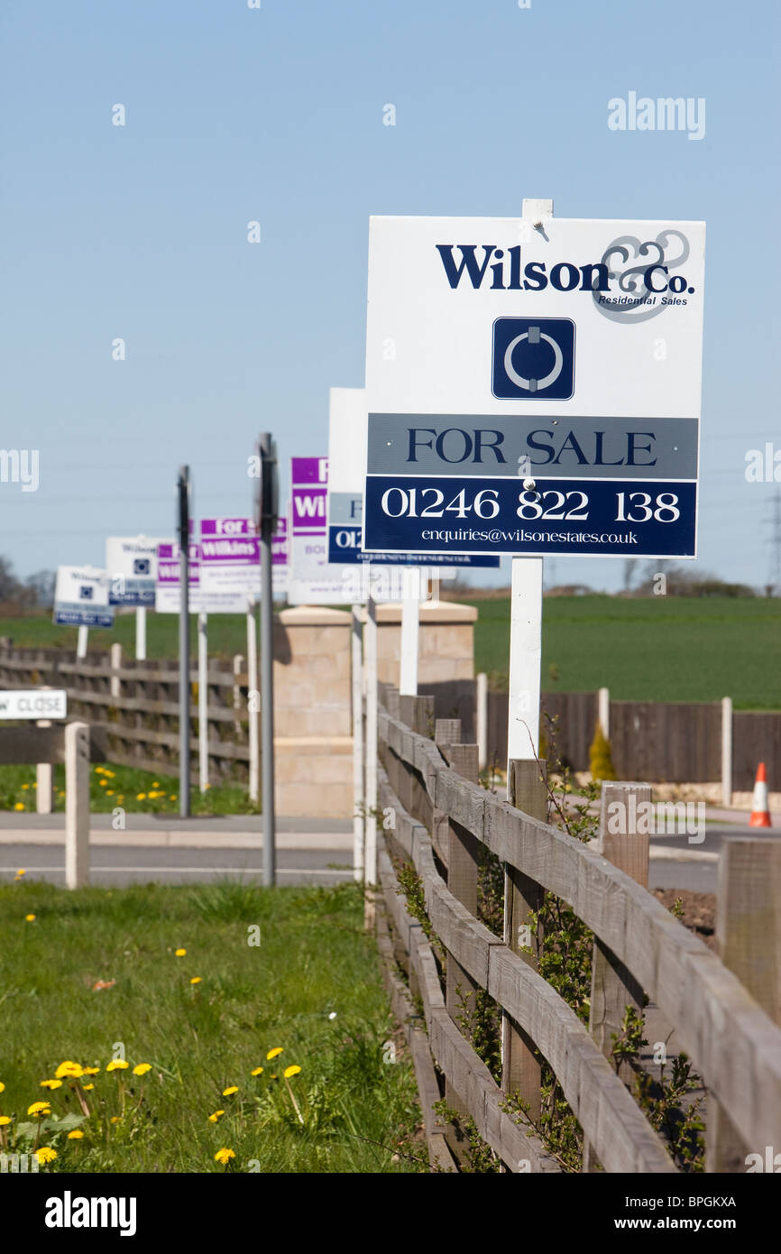 Property For Sale boards outside new houses in Nottinghamshire - Stock Image