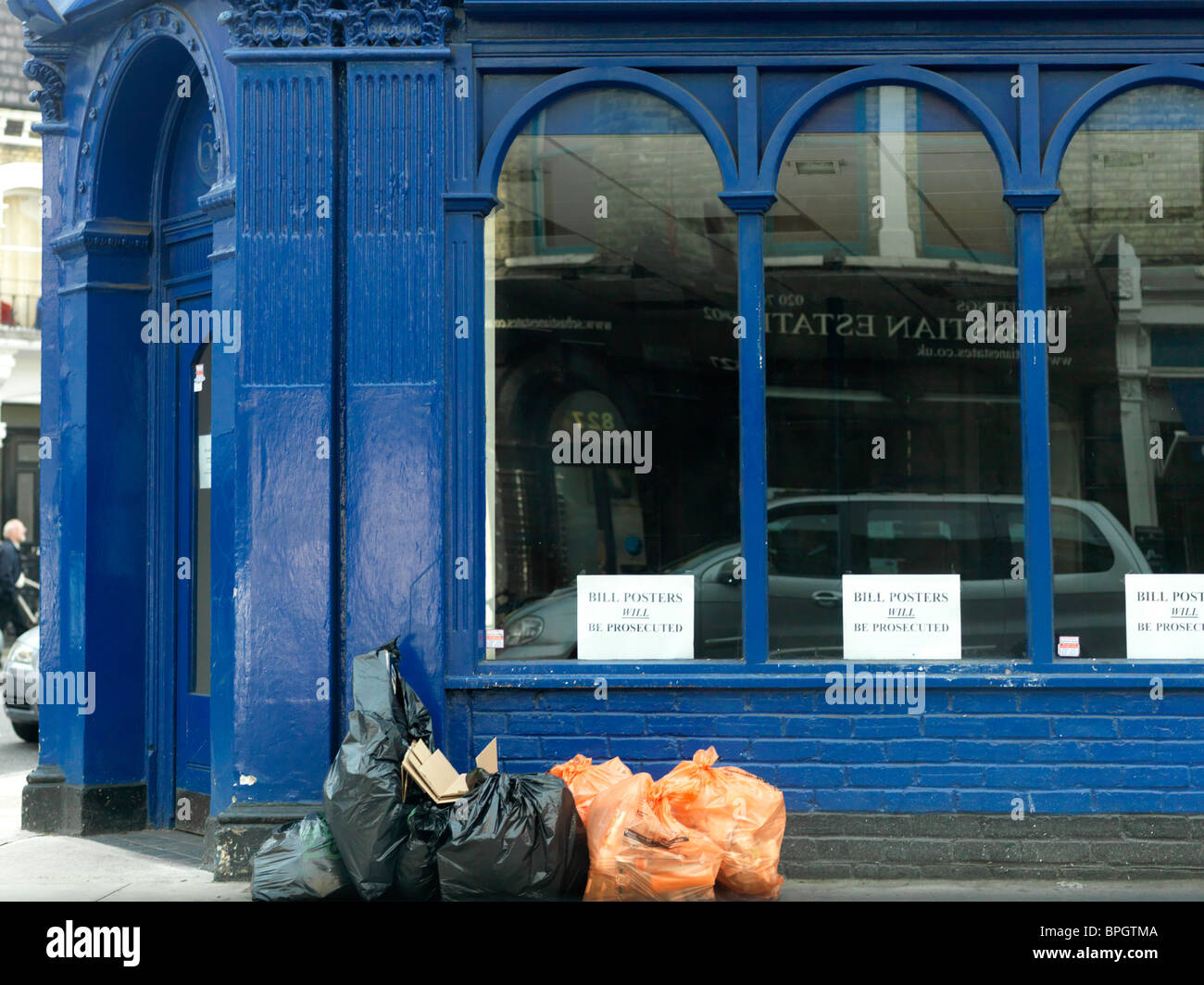 London England Fulham Rubbish Bags Outside Building - Stock Image