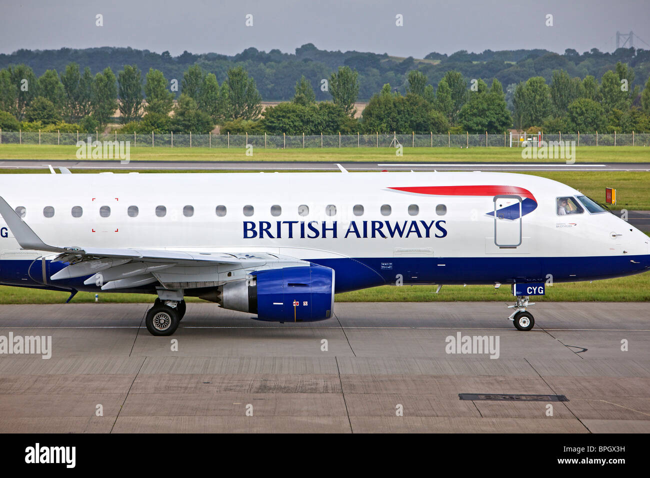 BA Cityflyer G-LCYG Embraer E170 STD at Edinburgh Airport side on - Stock Image