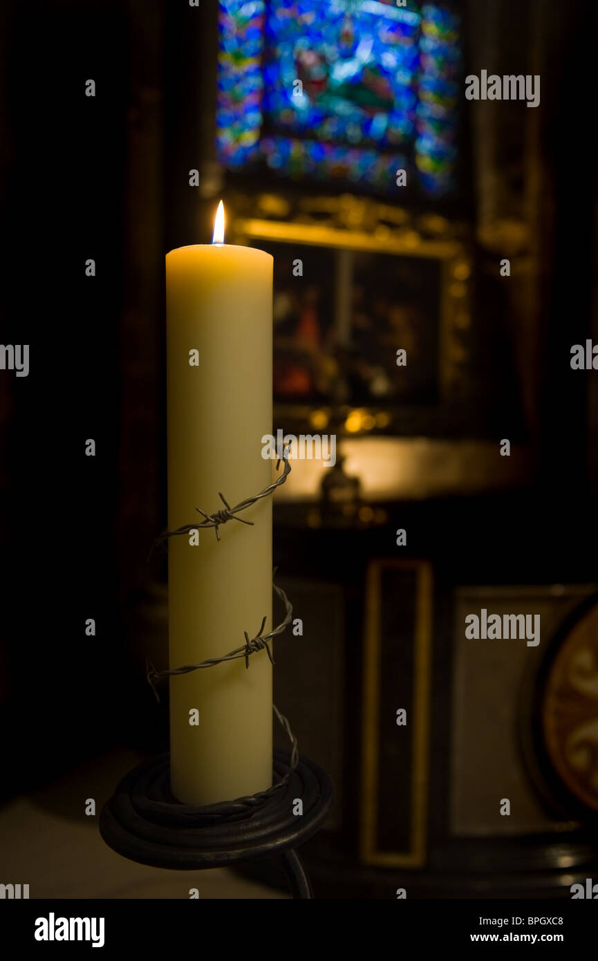 A Church Candle remembering all who suffer injustice in the World, Canterbury Cathedral, Kent - Stock Image