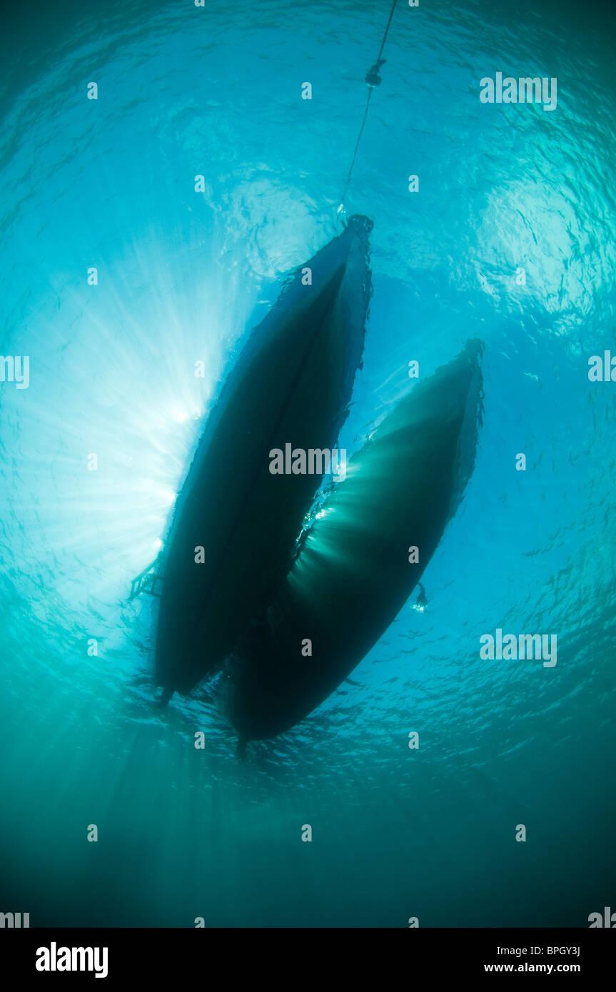 Silhouette of dive boats, Menjangan, Bali, Indonesia. - Stock Image