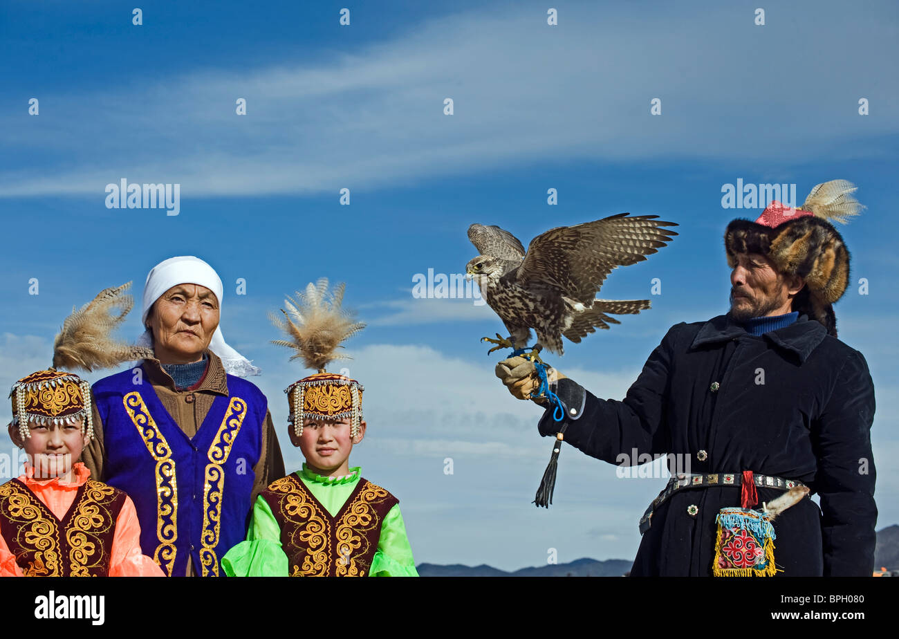 Kazakh hunter with Saker Falcon at Eagle hunters festival near Ulgii in western Mongolia October Stock Photo