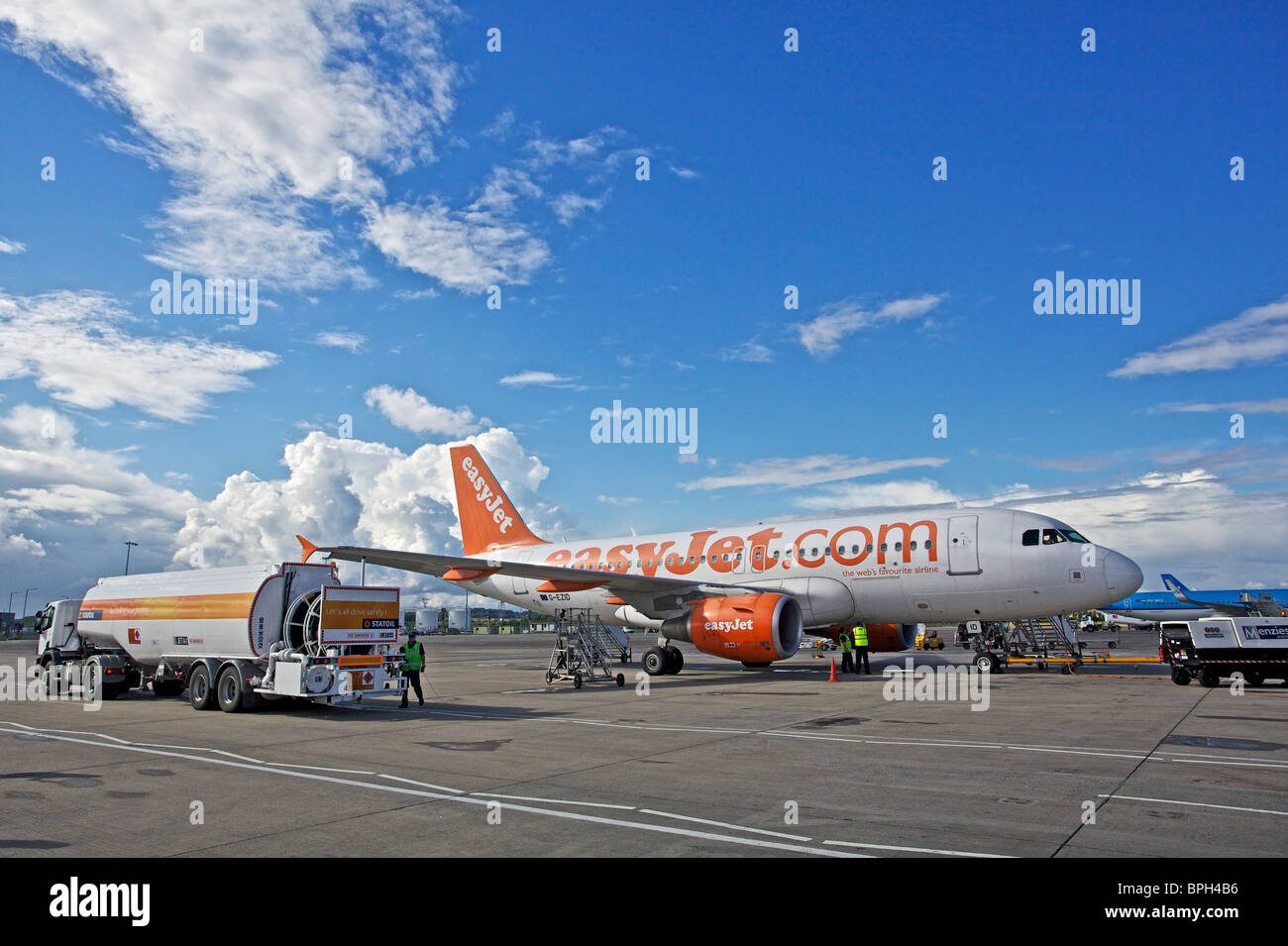 Easyjet plane refueling on the tarmac at Edinburgh airport, Scotland - Stock Image