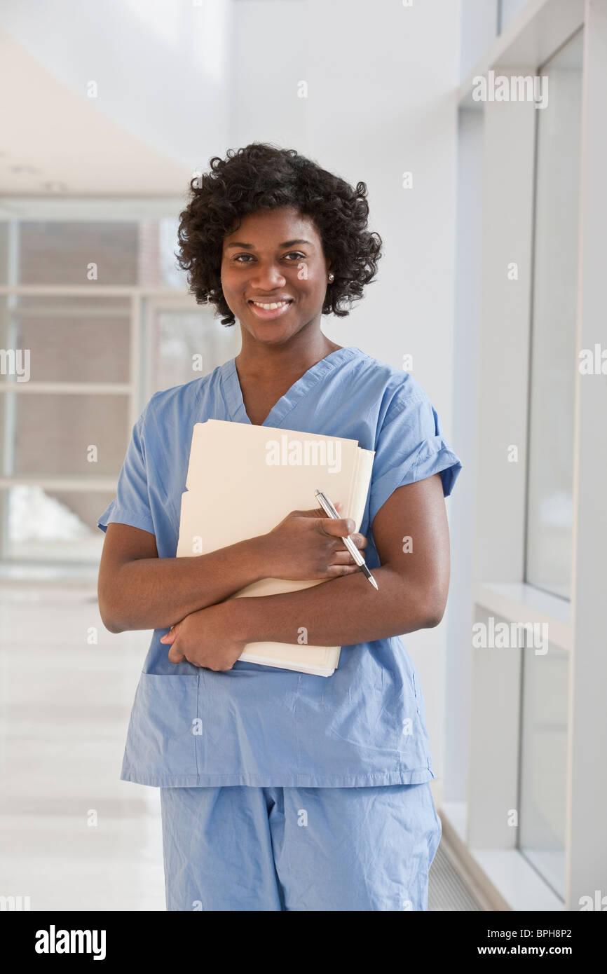 Portrait of a Jamaican female nurse smiling Stock Photo